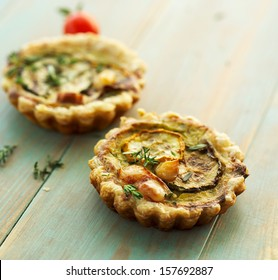 Quiche with grilled zucchini, smoked cheese and thyme