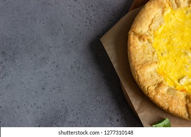 Quiche Lorraine with chicken on grey stone background. Thanksgiving or Christmas chicken homemade quiche with chicken. Traditional French food.