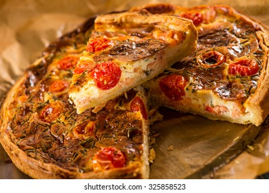 Quiche with salmon. Homemade tart with  smoked salmon and cherry tomatoes