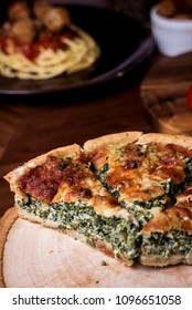 Quiche a savoury open tart or flan consisting of pastry crust with spinach mushrooms cheese.