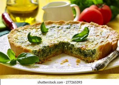 Quiche with spinach - traditional dish of french cuisine.