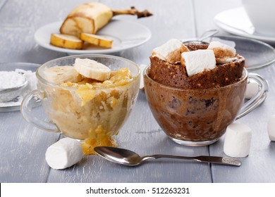 Quick banana cake and chocolate cake with marshmallow in a glass mugs from microwave