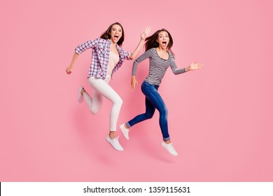 Quick! Full length body size photo of funky satisfied enthusiastic teens teenagers have free time scream laugh carefree fool childish isolated wear fashionable clothes on pink background