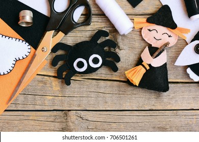 Quick Halloween crafts. Felt witch doll, spider decorations on a vintage wooden background. Needlework tools and materials. Easy felt Halloween crafts for preschoolers. Top view