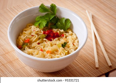 A quick healthy meal of ramen noodles with chopsticks.