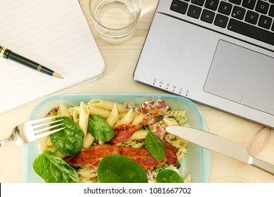 Quick Lunch. Lunch box in front of laptop. Concept of work overtime, delayed and stress at work.