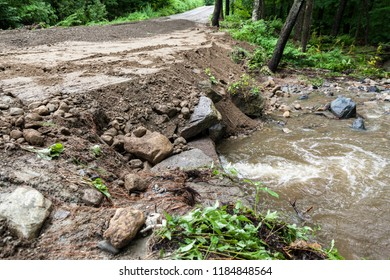 Quick repairs on a washed out dirt road from torrential rain and flooding.