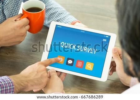 QUICK SURVEY CONCEPT ON TABLET PC Stock Photo (Edit Now