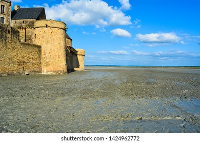 Quicksands near the walls of island Mont Saint-Michel, Normandy, France.