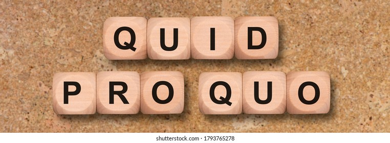 quid pro quo printed on wooden cubes