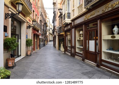 Quiet Calle Alvarez Quintero sidestreet with hotel and shops in Seville, Andalusia, Spain - April 23, 2015
