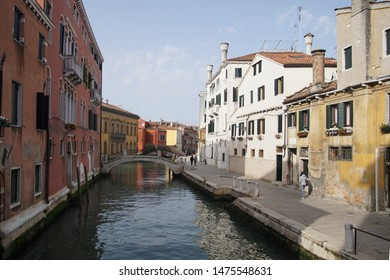 Quiet canal with bridges and boats in Venice, Italy