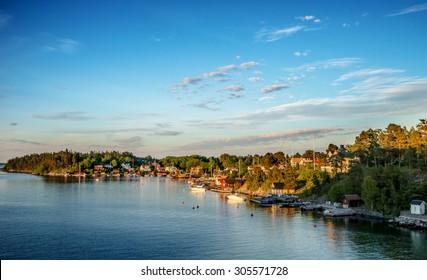 Quiet coastal village on Stockholm archipelago at evening (Kopmanholm, Sweden)