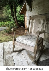 Quiet Comforts, rocking chair on a rustic porch