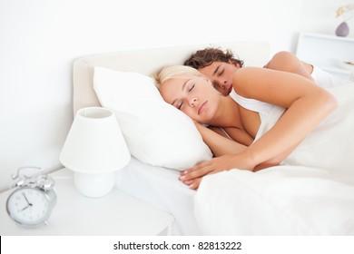 Quiet couple sleeping in their bedroom