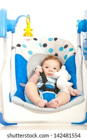 Quiet cute baby boy in a swing home against white background