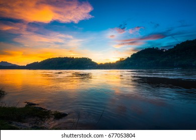 Quiet Dramatic Sunset by the Mekong River in Luang Prabang