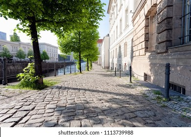 Quiet empty side street in historic district, along a river, on a spring afternoon - Berlin, Mitte, 2018