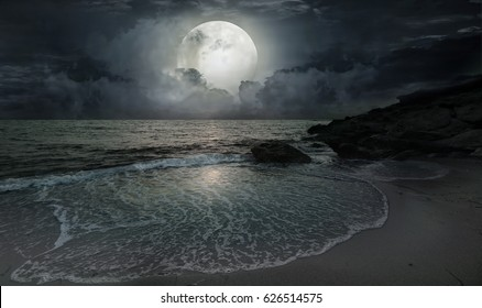 A quiet evening by the ocean with moonlight and a big moon