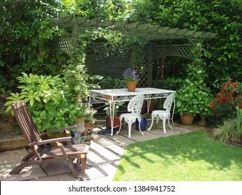 quiet garden corner with shady arbour