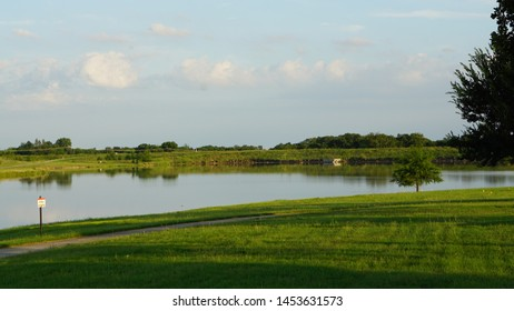 The quiet lake and green grass in Heartland, Texas.