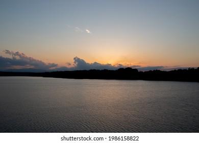 Quiet lake at sunset time in Tamako, Tokyo, Japan