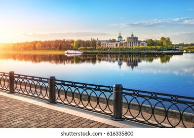 A quiet May evening in Tver and a river station with reflection in the mirror water of the Volga River
