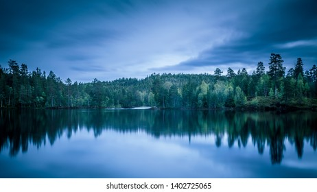 Quiet morning in the forest. This image was taken in a forest in Drammen, Norway. The lake is called Vrangla.
