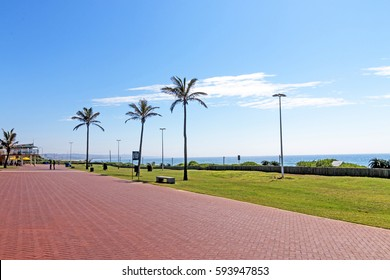 Quiet morning red paved promenade on Golden Mile Beachfront landscape in Durban South Africa