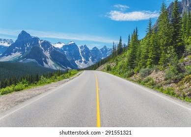 Quiet mountain road near Moraine Lake in Alberta, Canada