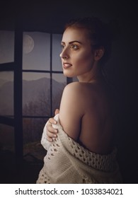 Quiet night. Art female portrait with red head beauty woman, open window and full moon