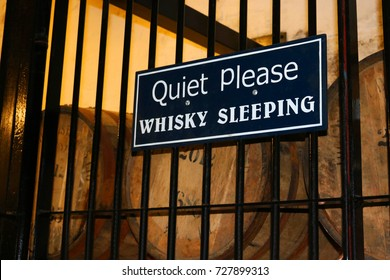 Quiet Please Whiskey Sleeping Sign with Wooden Barrels taken in Scotland