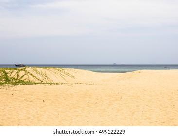 Quiet sandy beach on Tioman island in Malaysia