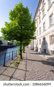 Quiet street in historic district, along a river, on a spring afternoon - Berlin