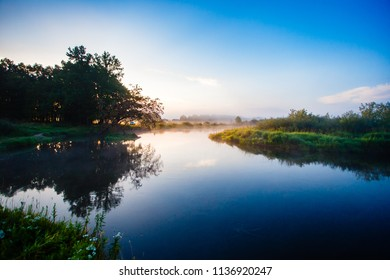 Quiet sunrise over river curve in Belarus. Silence at daybreak in summer