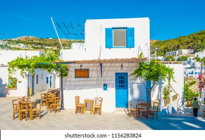 Quiet traditional greek street with white houses