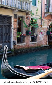 A quiet Venice canal with a gondola