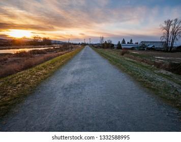 Quiet walking trail at sunrise in Pitt Meadows.