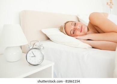 Quiet woman sleeping in her bedroom
