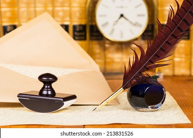Quill and ink with antique books in the background