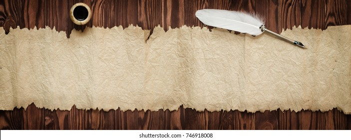 Quill with ink near the old scroll, background for text in high resolution