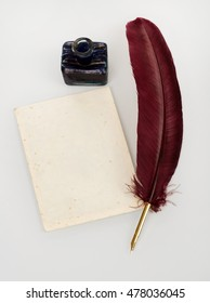 Quill, letter and ink well