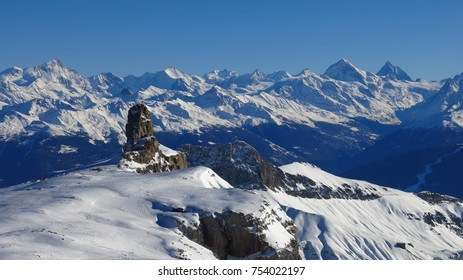 Quille du Diable, famous rock at the edge of the Diablerets glacier, Switzerland. Snow covered mountains.