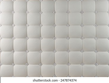Quilted mattress with patterned fabrics.