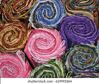Quilting jelly rolls close up. Fun color and textures. Spiral texture, great background.