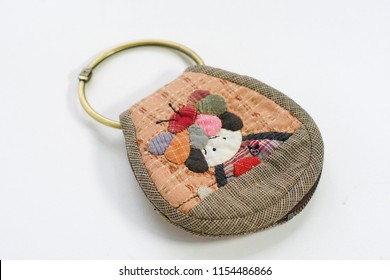 Quilting product. Key ring home pattern of quilt. Homemade Japanese quilt. Japanese handcraft on white background. Signed property release. Selective focus and free space for text,Design idea concept.