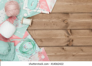 Quilting, Sewing, Knitting And Crochet Accessories. Fabric, Yarn Balls, Threads. Wooden Table. Copy Space