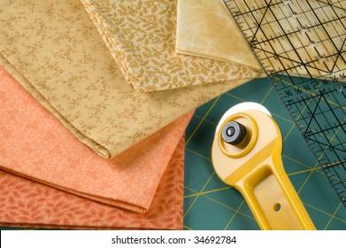 Quilting tools with orange material.
