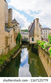 Quimper, France - August 8 2018: On the Rue de la Herse, looking down the River Steir flowing between old buildings towards the River Odet.