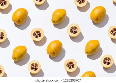 Quince on a colored background. Cut into half quince on a colored background. Seamless pattern with quince